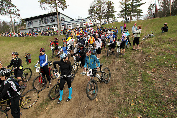 Record-Eagle/Keith King<br /> Riders await a wave start in Saturday's Mud, Sweat and Beers mountain bike races at the Mt. Holiday Ski and Recreation Area.