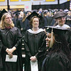 Record-Eagle/Keith King<br /> Jasmine Dorsey walks toward her seat during the Northwestern Michigan College commencement ceremony Saturday at Traverse City Central High School.