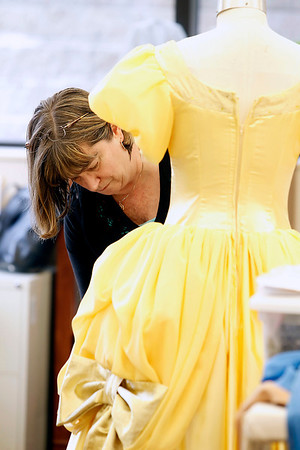 "Record-Eagle/Jan-Michael Stump<br /> Candy Hughes works on Belle's ball gown for the Interlochen Arts Academy student production of ""Beauty and the Beast,"" which opens Saturday, May 14 at Corson Auditorium."
