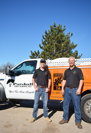 Record-Eagle/Dan Nielsen<br /> Corey Parshall, left, and Doug Parshall operate Parshall Tree Service, LLC.