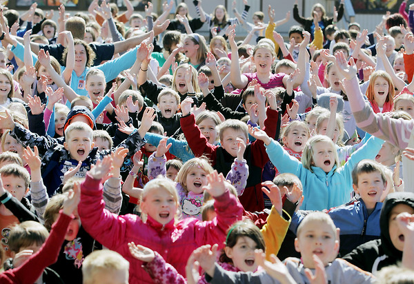"""Record-Eagle/Keith King<br /> Kingsley students and teachers dance and sing to the song """"YMCA"""" on the playground between Kingsley Middle School and Kingsley Elementary School on Wednesday during All Children Exercising Simultaneously (ACES). More than 800 Kingsley students, from preschool to eighth grade, participated in the worldwide event."""