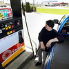 Record-Eagle/Keith King<br /> Larry Johnson, of Traverse City, puts gas into his pickup truck at the Shell gas station near the intersection of Garfield Road and Hammond Road.