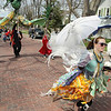 Record-Eagle/Keith King<br /> Gaia Nesvacil, of Traverse City, walks along Eighth Street Saturday as the Traverse City Earth Day Parade heads toward downtown.