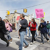 Record-Eagle/Keith King<br /> Protestors organized by We Are the People Michigan rally against Gov. Rick Snyder's budget policies on Saturday in downtown Traverse City. The crowd gathered on Front Street in front of Horizon Books an the State Theatre, then had lunch and heard several speakers at UAW Local 21 on Rose Street.