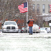 Record-Eagle/Nathan Payne<br /> About a dozen members of a group sponsored by the Grand Traverse Area Veterans Coolition stood for three hours Monday morning along Grandview Parkway holding flags in honor of Veteran's Day.