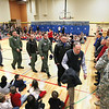 Record-Eagle/Keith King<br /> Veterans and United States Coast Guard Air Station Traverse City crew members proceed into the Long Lake Elementary School gymnasium Tuesday, November 13, 2012 where they'll be acknowledged during the school's monthly assembly. Tours of a United States Coast Guard MH-65C Dolphin helicopter from Air Station Traverse City were given to students by United States Coast Guard crew members prior to the assembly.