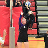 Record-Eagle/Jan-Michael Stump<br /> Leland's Samantha Sterkenburg (8) sets the ball in the first game of Monday's win over Forest Area.