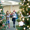 Record-Eagle/Jan-Michael Stump<br /> Wendy Buhr, left, and Dee White judge the professionally-decorated trees Thursday for the Zonta Festival Trees at the Hagerty Center. The annual event that raises money for the group's philanthropic events.