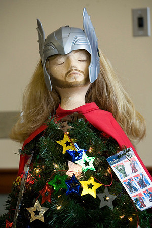 "Record-Eagle/Jan-Michael Stump<br /> ""Thor and the Avengers Christmas,"" tree, one of the professionally-designed trees at the Zonta Festival Trees at the Hagerty Center. The annual event, which raises money for the group's philanthropic events, runs through Sunday."
