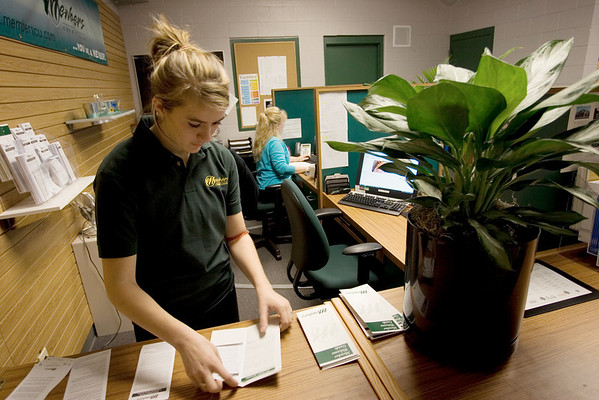 Record-Eagle/Keith King<br /> Kaitlyn Vezina, a student teller at Members Credit Union in the Traverse Bay Area Intermediate School District Career-Tech Center, inserts disclosure information into a Member Welcome Guide.