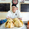 Record-Eagle/Keith King<br /> Bob Korten, owner of Crescent Bakery in Frankfort, poses near apple dumplings at his bakery.
