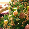 Record-Eagle/Jan-Michael Stump<br /> Grand Traverse Resort employee Don Sharp hangs ornaments on the 20-foot tree in the resort lobby on Thursday. The tree is the tallest of 20 inside the resort.