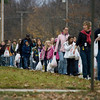 Record-Eagle/Keith King<br /> Traverse Heights students, parents and teachers walk toward the Father Fred Foundation with food to donate during the annual Father Fred Walk.