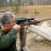 Record-Eagle/Keith King<br /> Jim Simons, of Interlochen, shoots at targets along Hoosier Valley Road as he prepares for the opening day of firearms deer season.