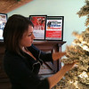 Record-Eagle/Kathy Gibbons<br /> Volunteer Maricia Klooster from Hagerty Insurance helps decorate the City Opera House for the holidays on Monday.