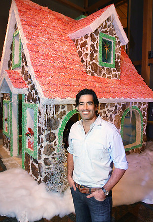 Record-Eagle/Keith King<br /> Design expert, HGTV star and Traverse City native Carter Oosterhouse stands Tuesday, November 20, 2012 at the Traverse City Great Wolf Lodge near the life-size gingerbread house he designed. Guests can dine inside the gingerbread house for a $20 donation with proceeds going toward Big Brothers Big Sisters.