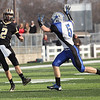 Record-Eagle/Jan-Michael Stump<br /> St. Ignace quarter back Tyler Snyder (2) throws a pass over Beal City's Austin Cook (5) in the division 8 semi-final game at Thirlby Field.