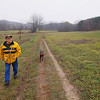 "Record-Eagle/Keith King<br /> Doug Hillock, of Traverse City, and his chocolate lab, Gus, walk Friday, November 9, 2012 at Hickory Meadows in Traverse City. ""You keep moving ahead,"" Hillock, who along with his dog, walks every day, said. ""Sometimes it's not as fast as you'd like but that's ok,"" Hillock said."