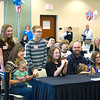 Record-Eagle/Jan-Michael Stump<br /> Dan and Mary Carlson adopted Ivory and Pearl Carlson to bring their family to ten members during Adoption Day Tuesday at the Hagerty Center. The proceedings were held at the center instead of a courtroom for allow for more space for families.