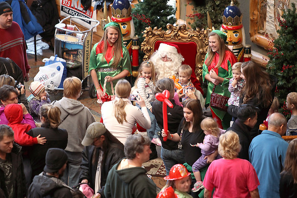 Record-Eagle/Jan-Michael Stump<br /> Santa Claus greets a crowd in the lobby of the Great Wolf Lodge to kick off Saturday's Toys for Tots campaign. Last year's campaign collected apporximately 25,000 toys that were distributed to an estimated 8,000 children in the region.
