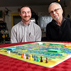 "Record-Eagle/Jan-Michael Stump<br /> Goodwill Industries of Northern Michigan Steet Outreach Coordinator Ryan Hannon, left, and photographer Alan Newton sit with ""Home Sweet Homeless,"" a board game which allows players to follow in the footsteps of a homeless person as they work towards a home, with setbacks and helping hands to give a great idea of the challenges faced by the homeless."