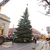 Record-Eagle/Jan-Michael Stump<br /> Traverse City Parks and Recreation workers put up at 40 foot blue spruce Wednesday at the intersection of Front and Cass Streets. The tree was donated by the Days Inn on Munson Avenue, with Elmer's providing the trailer and crane to transport and place the tree, which is placed in a manhole in Cass Street specifically for the tree.