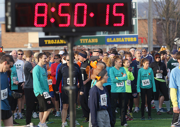 Record-Eagle/Keith King<br /> Participants stand on Thirlby Field Thursday, November 22, 2012 as they wait for the start of the Traverse City Turkey Trot. More than 2,300 people were registered for the event.