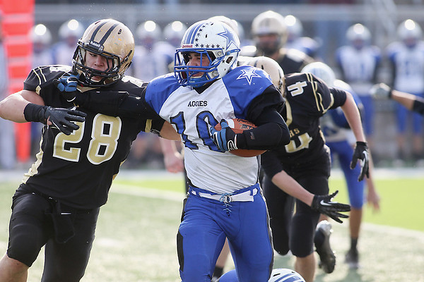 Record-Eagle/Jan-Michael Stump<br /> Beal City's Ty Rollin (10) stiff-arms St. Ignace's Joe Ostman (28) in the first half of Saturday's division 8 semi-final game at Thirlby Field.