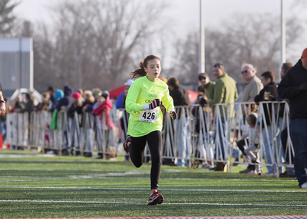 Record-Eagle/Keith King<br /> Aubrie Deal, of Traverse City, nears the finish line Thursday, November 22, 2012 at Thirlby Field as she finishes the Traverse City Turkey Trot. Deal finished first in the women's 5k. More than 2,300 people were registered for the Turkey Trot.