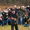 Record-Eagle/Jan-Michael Stump<br /> Wings of Wonder director Rebecca Lessard releases a 4-year-old bald eagle to the wild from Bower's Harbor Park on Saturday afternoon, not far from where it was found near death in October. Lessard, who founded the non-profit raptor rehabilitation center near Empire, rehabilitated the bird -- including feeding it by hand -- until it was strong enough to return to the wild. Lessard held the eagle while a large crowd took pictures, then released it on a count of five. It flew over the crowd and off into a group of trees and out of sight, south of the park.