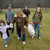 Record-Eagle/Keith King<br /> Melanie Strang, far left, 8, of Kingsley, holds the hand of her mother, Cheryl Karpinski-Strang, as Michael Strang; Zachary Ross, 16; and Faith Ross, 12, walk their dogs at Mayfield Pond Park on Monday.