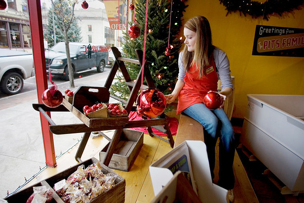 Record-Eagle/Keith King<br /> Heather Donn, store manager at Cherry Republic in downtown Traverse City, decorates the store's front window Wednesday, November 24, 2010 in preparation for the holiday shopping season.