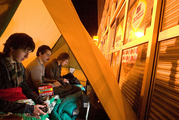 "Record-Eagle/Jan-Michael Stump<br /> From left, Nathan Holtray (cq), Samual Plamondon (cq) and Adam Findley (cq), all of Traverse City, play ""Left for Dead 2"" on three XBoxes and televisions inside their tent outside Best Buy Thursday night, where they were first in line after arriving around 10 p.m. Wednesday, in anticipation of Black Friday sales."