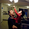 Record-Eagle/Keith King<br /> Brian LaParr, of Traverse City, holds his foster son, Damian, 2, as he pulls on a ceiling fan's chain. Brian and his wife, Terri, plan to finalize adoption of Damian today in 13th Circuit Court as part of Adoption Day.