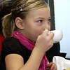 "Record-Eagle/Garret Leiva<br /> Meredith Gallagher, 6, of Traverse City, sips her pomegranate-flavored tea at the Zonta Club of Traverse City Festival of Trees ""Dolly & Me Tea"" Sunday at the Hagerty Center."