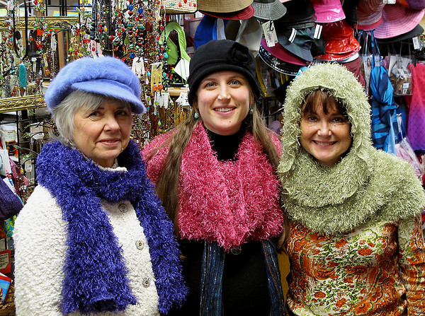 Record-Eagle/Mark Urban<br /> From left, Beverly Anderson, Hollie Anderson and Suzanne Weiler model the 'magic scarf' at Diversions in Traverse City.