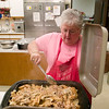 Record-Eagle/Jan-Michael Stump<br /> Mae Smith  prepares lunch at the Salvation Army on Friday. Smith has been the head cook for seven years, preparing lunches Monday, Wednesday and Friday for as many as 140 people.