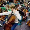 "Record-Eagle/Keith King<br /> Kieran Laursen, 13, of Traverse City, plays the cello as the Traverse Symphony Orchestra Civic Prelude Strings rehearse at Central United Methodist Church Tuesday, November 23, 2010 for the performance, ""Winter Celebration,"" Tuesday, November 30, 2010 at the City Opera House."