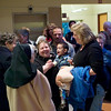 Record-Eagle/Jan-Michael Stump<br /> Surrounded by family members, Terri LaParr, center, carries her son, Damian LaParr, into 13th Circuit Court in Traverse City where she and her husband, Brian LaParr, adopted him Tuesday on Adoption Day. The event, in its seventh year, celebrates the finalization of adoption proceedings for families in more than 30 courts across the state.