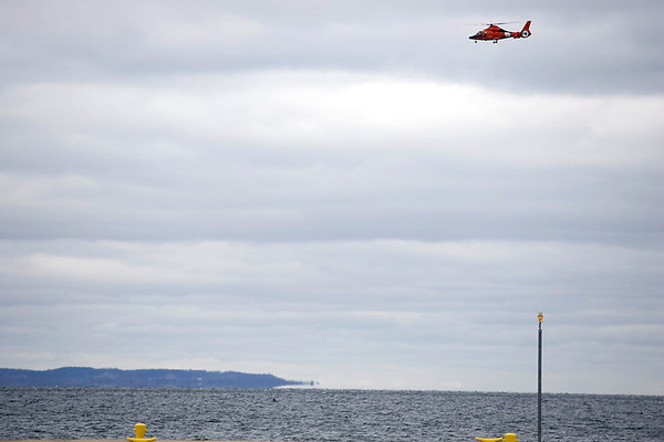 Record-Eagle/Keith King<br /> A United States Coast Guard helicopter investigates a report of an individual in West Grand Traverse Bay Tuesday.