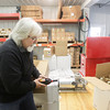 Record-Eagle/Keith King<br /> Doug Coster, sales manager, uses a machine to capsule a bottle of cherry mead Thursday, November 21, 2013 at St. Ambrose Cellars/ St. Ambrose Meadery/ Sleeping Bear Farms in Homestead Township.
