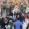 Record-Eagle/Keith King<br /> Shoppers walk Friday, November 29, 2013, the day after Thanksgiving Day, through downtown Traverse City.