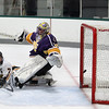 Record-Eagle/Keith King<br /> Traverse City Central's Cooper Macdonell (7) scores a goal against Warren De La Salle goalie Joey Lopezzi Saturday, November 24, 2012 at Centre ICE.