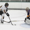 Record-Eagle/Keith King<br /> Traverse City Central's Mitchell Ward (10) tries to score a goal against Warren De La Salle goalie Joey Lopezzi Saturday, November 24, 2012 at Centre ICE.