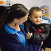 Record-Eagle/Keith King<br /> Jayvin Bartlett, 19 months, smiles as he is held by his mother, Jennifer Bartlett, Tuesday, November 30, 2010 at Angel Care Child Care.