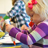 Record-Eagle/Vanessa McCray<br /> Abby Kime, 2, of Traverse City, works on a holiday craft project at the Great Lakes Children's Museum. The museum is among the area agencies that are part of the Great Start Traverse Bay/Manistee Collaborative. The collaborative, which covers six counties, has developed a strategic plan that focuses on strengthening the community's early childhood programs and resources.