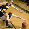 Record-Eagle/Keith King<br /> Traverse City Central's Olivia DeBortoli dives for the loose ball against Grand Haven's Jordan Keefe Friday, December 3, 2010 at Traverse City Central.