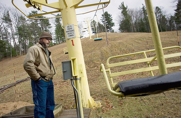 Record-Eagle/Keith King<br /> Andy Reagan, mountain manager at Mt. Holiday Ski & Recreation Area in Traverse City, operates the chairlift Tuesday during the annual preseason state inspection. The checkup came just in time; there's a pretty good chance of snow showers every day through the weekend.