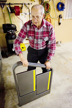 Record-Eagle/Keith King<br /> Glenn Schrock, of Traverse City, demonstrates the Handi-Steps he invented.