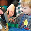 Record-Eagle/Vanessa McCray<br /> Leland Roskamp, 2, creates a Thanksgiving turkey craft project at the Great Lakes Children's Museum, a collaborative member.